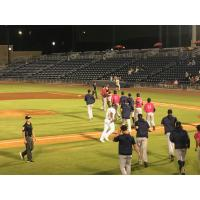 Pensacola Blue Wahoos rush the field after winning Game Four