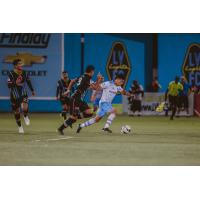 Sebastain Velasquez of El Paso Locomotive FC navigates past Las Vegas Lights FC