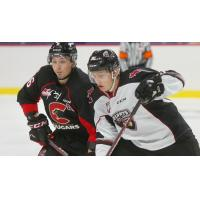 Vancouver Giants right wing Justin Lies (right) vs. the Prince George Cougars