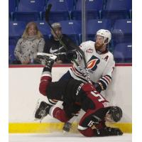 Vancouver Giants left wing Owen Hardy battles the Kamloops Blazers